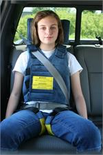 Chamberlain booster car seat with positioning vest, used with car seat belt for restrain.