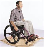 Wheelchair Platform Rocker by TherAdapt with man and wheelchair